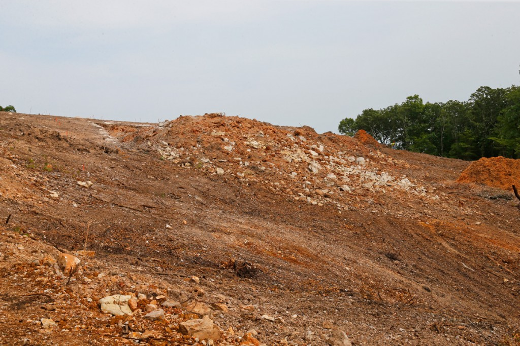 Hillside area after the blasting was done on Thursday August 23rd. The mound of rock and soil is the material moved down the hill by the blast. (08/23/18)