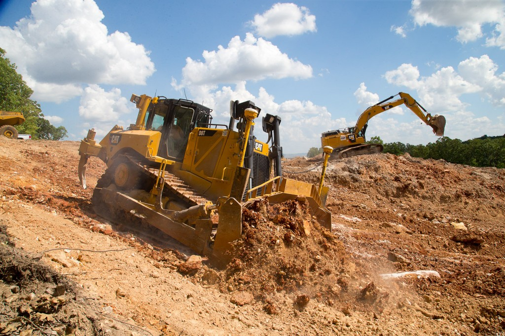 Bulldozer and excavator working in tandem to remove soil on the new range site. (09/05/18)